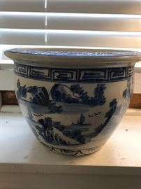 One of two blue and white planters