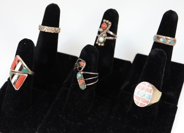 "Six Silver, Turquoise, Onyx, Mother of Pearl, and Coral Rings - Only one is marked ""Sterling 925"". One band ring is misshapen, minor wear overall."