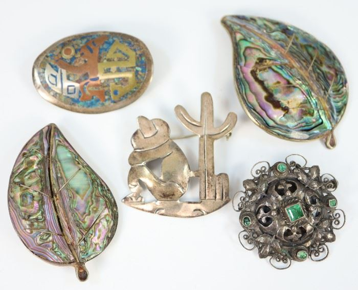 "Five Silver Brooches. Including four made in Mexico, two of which inset with abalone and another mixed metal and turquoise, as well as one Eastern European, possibly Russian, marked both ""84"" and ""800"". Minor wear. Up to 2 1/2"" wide."