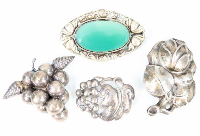 "Four Sterling and Silver Brooches - Danish style, naturalistic motifs including one stamped ""DKS/800"", one ""Baur Sterling"", one ""Silver Mexico"", and one unmarked inset with green stone. Minor wear, pin backs are bent. Up to 2 1/2"" wide."