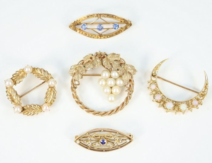 "Five Yellow Gold, Pearl, Opal, and Gemstone Brooches -  Including 2 of circular form with pearl accents, 1 crescent form with opals, and 2 of pointed oval form, each with blue gemstones.  Four are stamped ""14K"", the other, with three blue gemstones, is marked on the closure, possibly ""CH"".  Minor wear to each.  Up to 1 1/4"" diameter.  Totaling 17.8 grams."