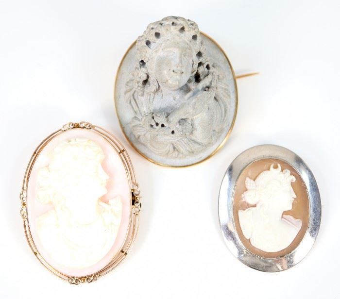"Three 19th Century Cameo Brooches.  Including 2 carved shell cameos, one featuring Diana the Huntress and one featuring the profile of a young woman, together with 1 high relief composition figure of a Bacchante.  No apparent markings.  Wear to each, the Bacchante brooch has some minor cracks and a flake verso.  Up to 1 1/2 x 1 7/8"" high.  Totaling 61.5 grams."