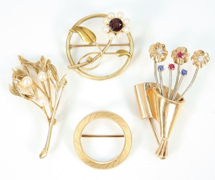 "Four Yellow Gold Brooches - Including 1 round 10 kt yellow gold brooch with pearl and garnet flower, 1 14 kt yellow gold round brooch, 1 14 kt yellow gold and gemstone bouquet of flowers brooch, and 1 14 kt yellow gold and pearl leafy branch form brooch.  All are marked accordingly.  Minor wear to each.  Up to 2"" long.  Totaling 25.9 grams."