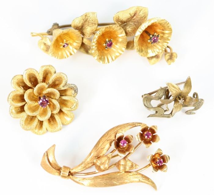 "Four Gold & Gemstone Clad Brooches -  Including one 18 kt yellow gold flower bouquet form brooch with rubies, stamped ""18K Italy Pavi"", together with three other unmarked gold tone floriform brooches each enhanced by various gemstones.  Wear to each, two of the unmarked pieces with solder evident at the closures.  Up to 2.25"" long.  Totaling 22.2 grams."
