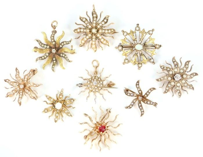 "A Group of Nine 19th & 20th Century Starburst Brooches - Each clad with either enhancement gemstones, including opals, or pearls. One stamped ""14 k"", another ""10 k"", the rest are unmarked. Minor wear to each, with two missing a seed pearl each. Up to 1"" in diameter. Totaling 27.8 grams."