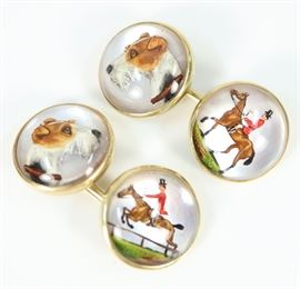 "A Pair of 14 kt Gold & Reverse Intaglio Crystal Cufflinks by Abercrombie & Fitch -  Circular shape, centered by a rock crystal cabochon carved and painted to depict equestrian scenes consisting of a terrier and a horse with rider. Both are stamped ""14 k AF"" and engraved ""Jean, 5.31.37"". Very minor wear. Diameter of each approximately 0.5"". Totaling 10.9 grams"