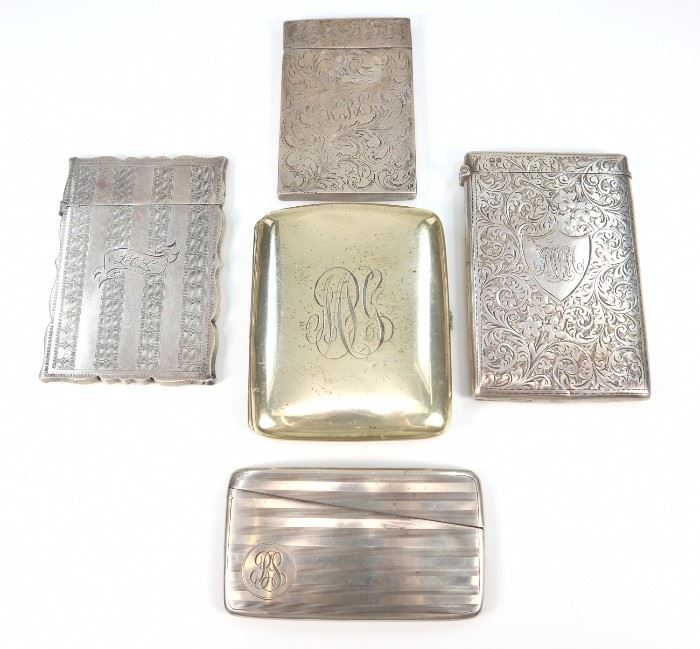"Four 19th Century Silver Card Cases &  One Cigarette Case -  Including  4 silver card cases, one by Watrous Mfg. Co. and one with marks by William Neale (Chester, date mark indicating 1902), two are unmarked, together with 1 Gorham sterling cigarette case.  All pieces are monogrammed.  Light wear and scratches to each, two card cases with indentations at the corners and indentation noted to the cigarette case.  Up to 2 1/2"" x 3 3/4"" high.  Totaling approximately 9.07 oz."
