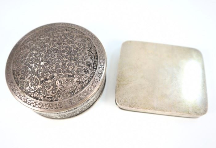 "An American Sterling Box & a Persian Silver Box -  Consisting of 1 simple sterling box with fitted interior stamped with Arthur Stone maker's mark and ""Sterling"" together with 1 round Persian .875 silver box stamped with standard ""84"" and two other markings.  Some wear and light scratches to each.  Totaling 7.16 troy oz.  3"" in width and diameter."