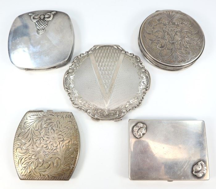 "Three American & Two Continental Silver Compacts -  American sterling compacts include 1 by The Thomae Co., 1 by Birks, and 1 By R. Blackington & Co., each is marked accordingly with maker's mark and ""Sterling""; together with 1 Czechoslovakian silver compact stamped ""835"" along with the mark used c. 1929-1942 and ""PA"" enclosed within a rectangle, and 1 other compact, possibly German, stamped with worn markings and ""800"".  Two are monogrammed.  All show some wear, light scratches.  Up to 3 1/2"" x 3 1/4""."