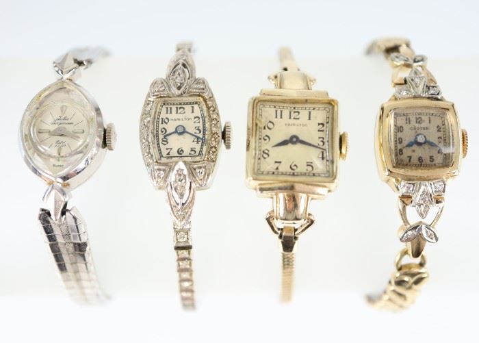 Four Vintage Ladies Wrist Watches -  Including 1 Jules Jurgensen 14 kt white gold wrist watch, 1 Croton 14 kt yellow gold wrist watch with diamond enhancements, and, 1 Hamilton 14 kt yellow gold watch, and  1 Hamilton 14 kt white gold wrist watch with diamonds at the face and band.  Each is marked accordingly.  Some wear and light scratches to each, the crystal is damaged on the Jurgensen watch; not working when cataloged.