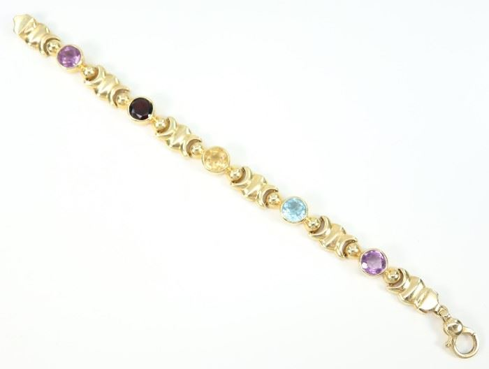"A 14 kt Yellow Gold & Semi-Precious Stone Bracelet -  Yellow gold bracelet set with 5 gemstones including amethyst and garnet.  Stamped ""14 Kt Italy"" and ""RZN"".  Minor wear noted.  7 1/4"" long.  Totaling 25.2 grams."
