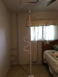 Floor to ceiling handicap pole to help getting out of bed.