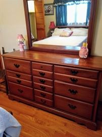 Triple dresser and mirror for 1950's maple set. Made by Drew. $200.