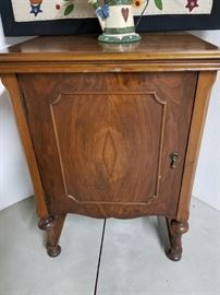 Antique sewing machine cabinet with sewing machine inside