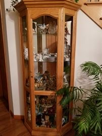 Solid oak display cabinet - many collectibles for sale sold separately.  Snow babies, Ty, etc.