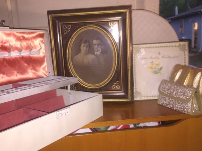 Vintage jewelry box, old photos some in frames, vintage purses & hankies still in original packing