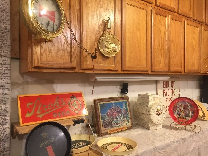 Budweiser clock motion pocket watch lighted, Strohs Beer light, Genesee Firefighter lighted Beer Sign, Beer trays and One with St. Louis and the arch pretty neat, Falstaff Insulated Beer Keg Dispenser