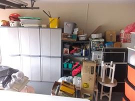 Lots of storage cabinets full of goodies Christmas, holiday, tools, misc