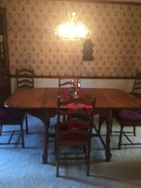 BEAUTIFUL WALNUT DROP LEAF TABLE AND 6 CHAIRS  WITH PADDING FOR TABLE  VERY VERY NICE CONDITION