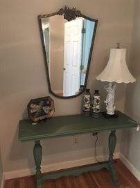 Anthropologie mirror, super cool lamp and awesome painted sofa table