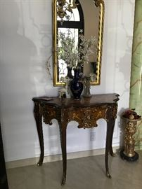 Valencia, Spain. Louis XV style console table shown with tall 24kt gold painted hall mirror.