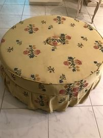Tufted, skirted large scale round ottoman.