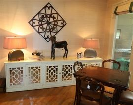 White lacquer buffet or credenza, decorative metal art, Ram, and Asian-style lamps