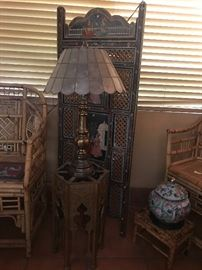 The gold table, screen and square rattan foot stool are sold.