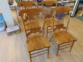 4 Nice wood press back dining chairs.