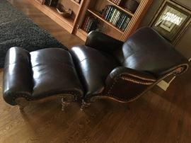 Go a new way with this modern leather chair and ottoman.  The buttery leather and unique  style make it a sure favorite!