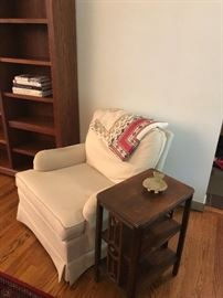 Upholstered arm chair, side table and bookcase, along with crewel and needlepoint cloths