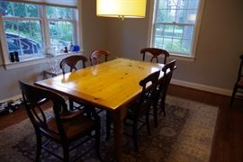 Dining room table with two extenders and 8 pottery barn chairs