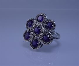 Ring with deep amethyst colored gemstones set in sterling silver, 10.7 grams, size 9, auction lot 20