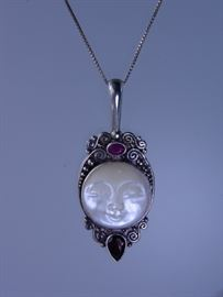 "Vintage Sajen pendant only (chain sold separately), sterling silver with mother of pearl carved moon face, with a ruby colored gemstone and a red garnet colored gemstone, 2 1/2"" tall by 1"" wide, 15 grams, auction lot 8, matching earrings also available separately"
