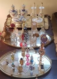 Collection of vintage perfume bottles and mirror dresser trays
