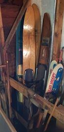 Vintage water skis, including Snoopy kid's skis