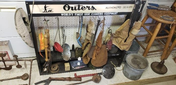 Vintage hunting and fishing items and Outers display