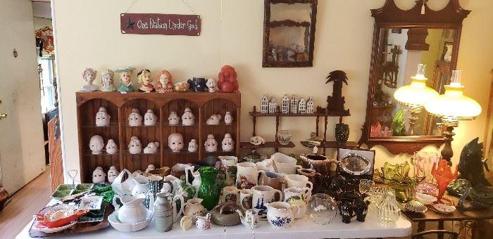 Vintage bisque doll heads, head vases, KLR airline liquor house bottles, ashtrays, dozens of pitchers
