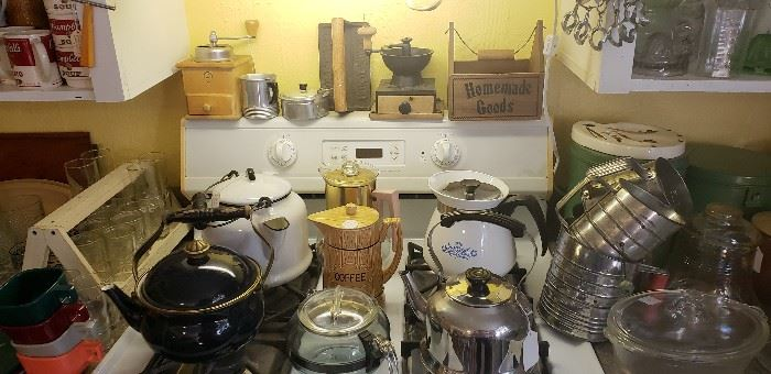 Vintage coffee pots, sifters, coffee grinders, kitchen items