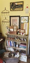 Vintage signs, vintage rakes, crystal stemware, cookbooks, covered chicken dishes, cow creamers