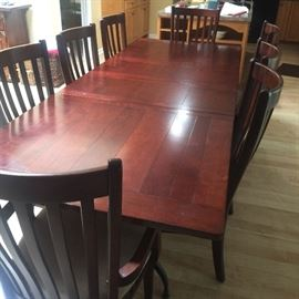 Nice dinning room table with 8 chairs leaves