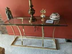 $50  Glass top console table with brass base