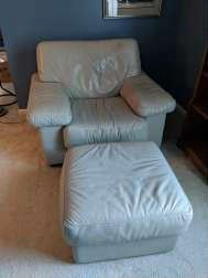 $100  Natuzzi grey leather chair and footstool