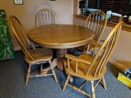 $275   Round oak table with chairs and 2 leaves