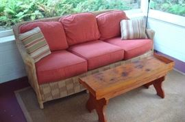 Wicker porch sofa and table.