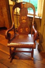 Hand decorated antique rocking chair.