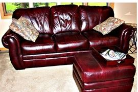 Leather sofa - has matching chair and ottoman.