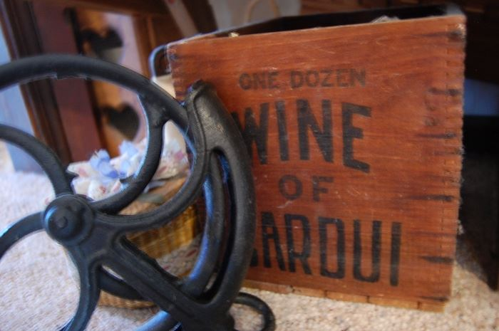 Cast iron barn pulley, advertising crate