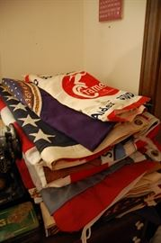 Antique flags, some advertising banners