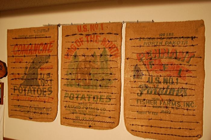 Barbed wire collection on burlap advertising sacks